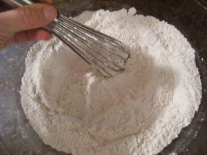 whisking flour for scones