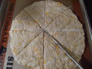 sliced and unbaked dough for cheddar-apple scones