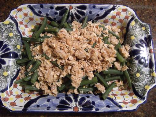 Freshly steamed green beans are covered with a savory streusel of oats, garlic, and Parmesan cheese. Even picky eaters will eat these veggies! Get the recipe from ComfortablyDomestic.com