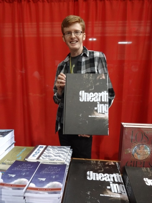Leigh Walton at Top Shelf demonstrates just how big the limited hardcover of Alan Moore's Unearthing is
