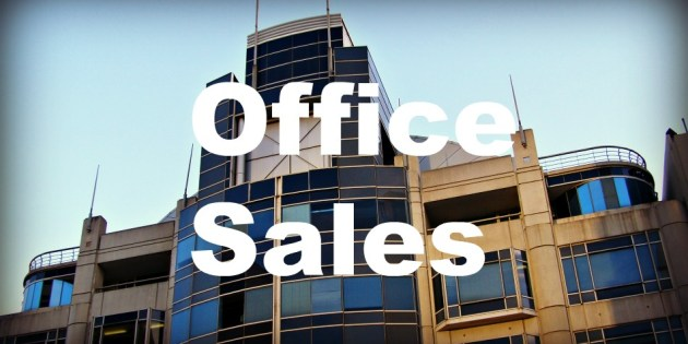 city building with sales words applied over