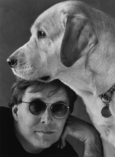 Portrait of Stephen Kuusisto with his dog.