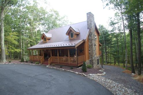 Log house front view with porch decor