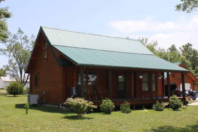 Log cabin roof systems and design Cabins with metal roofs