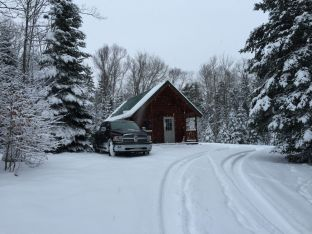 Heritage Vacation cabin in snow in MI
