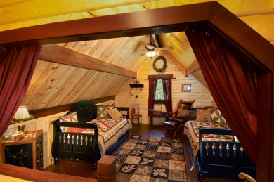 Log cabin loft with privacy curtains