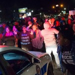 Two Ferguson police officers shot as black power rally was ending