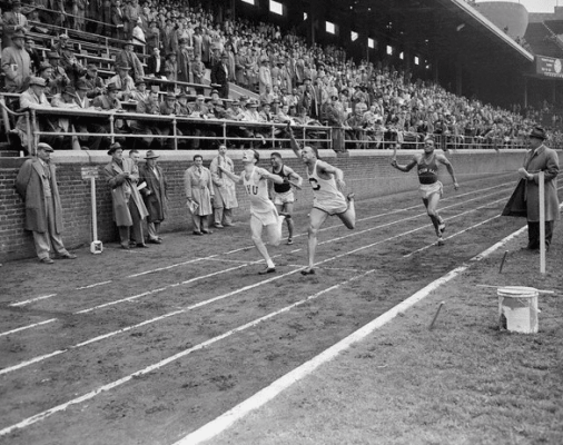 vintage men sprinting grass field track 1930s 1920s