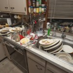Dirty dishes piled up in sink after a party
