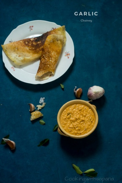 Bowl of garlic chutney with dosa