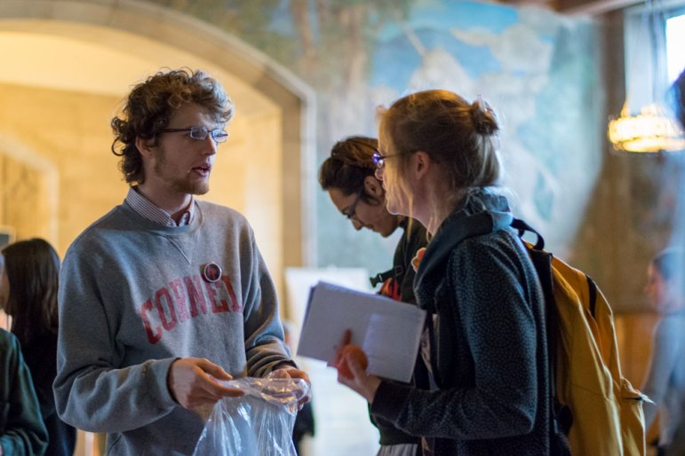 The Cornell Independent Student Union urges the University to divest from fossil fuels and adjust its governance system in Willard Straight Hall Thursday. (Varun Hegde / Sun Staff Photographer)