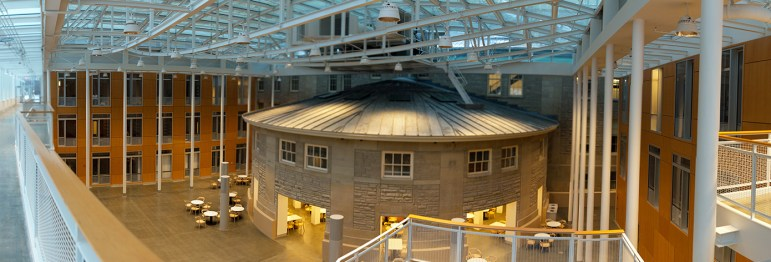 A panoramic photo shows the inside atrium of the new Karman Hall, which contains the rotunda of Goldwin Smith Hall.