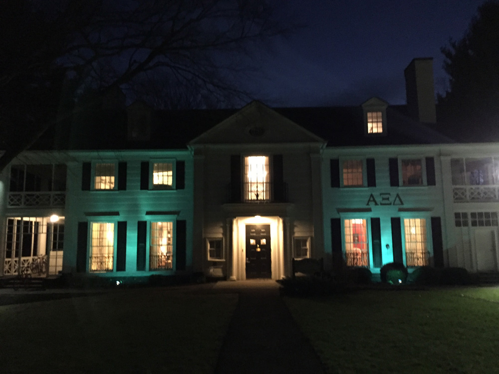 The Alpha Xi Delta house on North Campus lights up its property to raise awareness for those with autism.