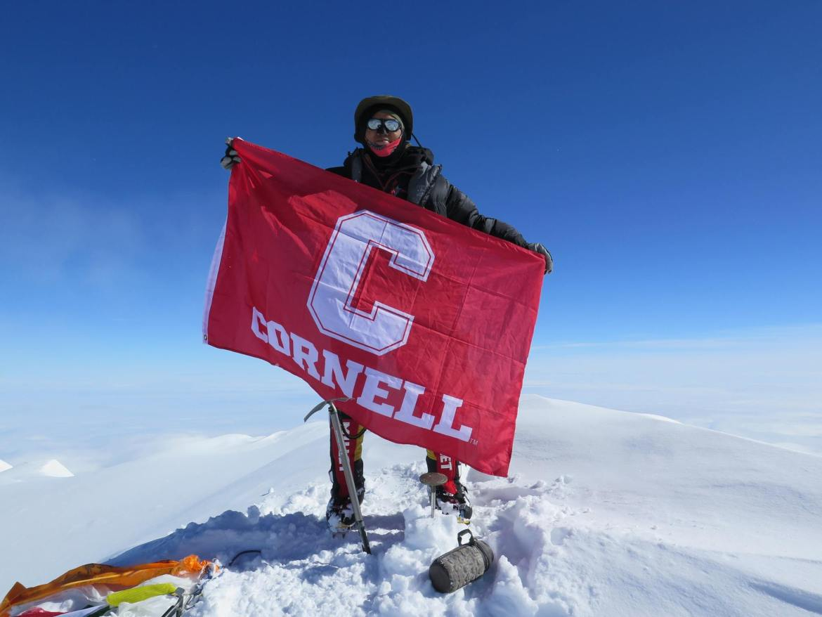 Kunwoo Kim '15 proudly holds up the Cornell flag at the 20,310-foot summit of Denali on the fourth of July.