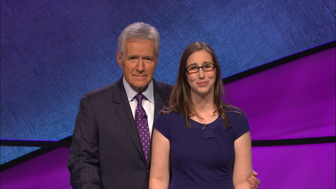 Lisa Schlitt '07 with Alex Trebek, on the sets of Jeopardy!, the popular game show. Photo courtesy of Jeopardy Productions, Inc.