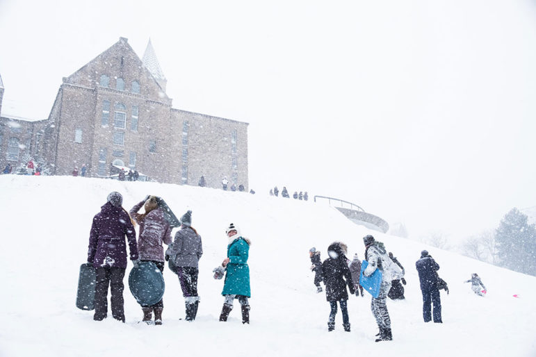 Dozens of students skied, sledded and rolled down Libe Slope during a rare Cornell snow day.