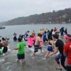Hundreds entered the frigid water of Cayuga Lake to raise money for New York Special Olympics athletes on Saturday.