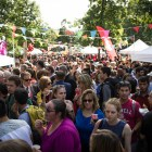 Hundreds of Cornellians pour onto the Arts Quad after the ceremony of the inauguration of Martha Pollack for a street fair.