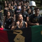 Led by Black Students United co-chair Delmar Fears '19, center, hundreds of students march from Day Hall to Willard Straight Hall on Wednesday, Sept. 20, 2017, responding in part to an assault of a black student that the student believes was motivated by his race.