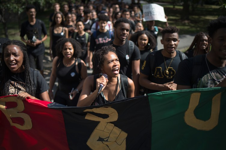 Led by Black Students United co-chair Delmar Fears '19, center, hundreds of students marched from Day Hall to Willard Straight Hall on Wednesday, Sept. 20, 2017, responding in part to the reported assault of a black student.