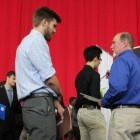 Students network with employers, appreciating the shorter wait times and opportunity to speak.