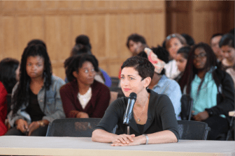 Laura Spitz, vice provost for international affairs, fields questions from Student Assembly members on Thursday evening as students against Cornell's initial elimination of FESP look on.