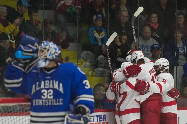 Yates celebrates with his teammates after his first goal of the night.