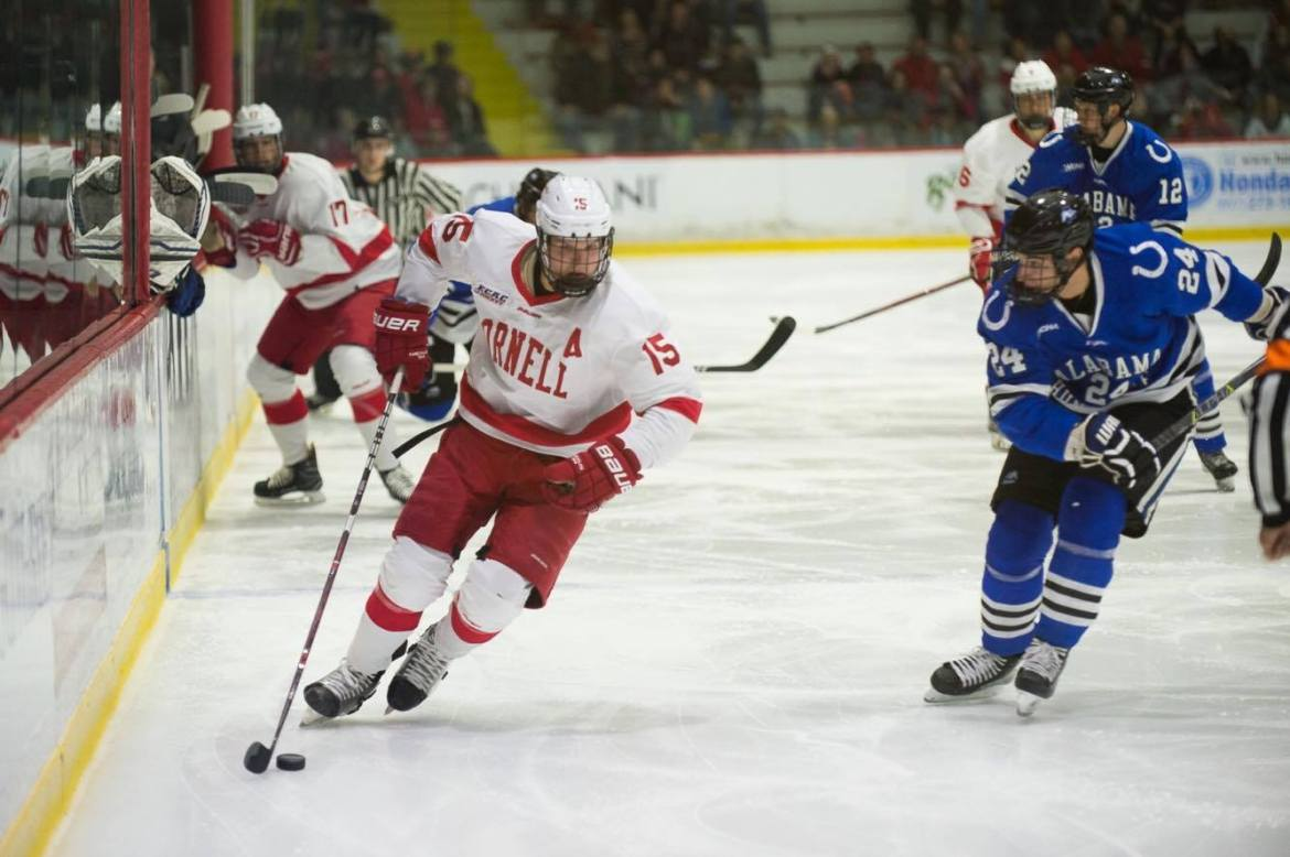 Senior forward Trevor Yates skates down the boards in the team's 3-0 win over UAH Saturday. The alternate captain had two goals in the victory.