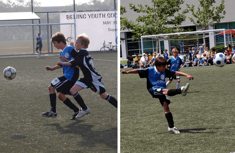 Ryan (left) and Connor playing soccer in their youth in China.