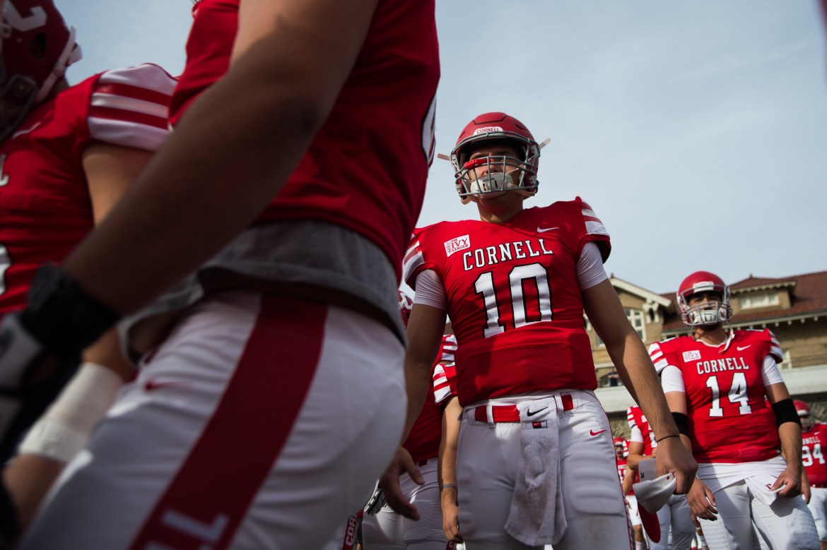 Quarterback Jake Jatis walks out onto the field on Homecoming against Brown Saturday. The senior had 42 rushing yards on six attempts.