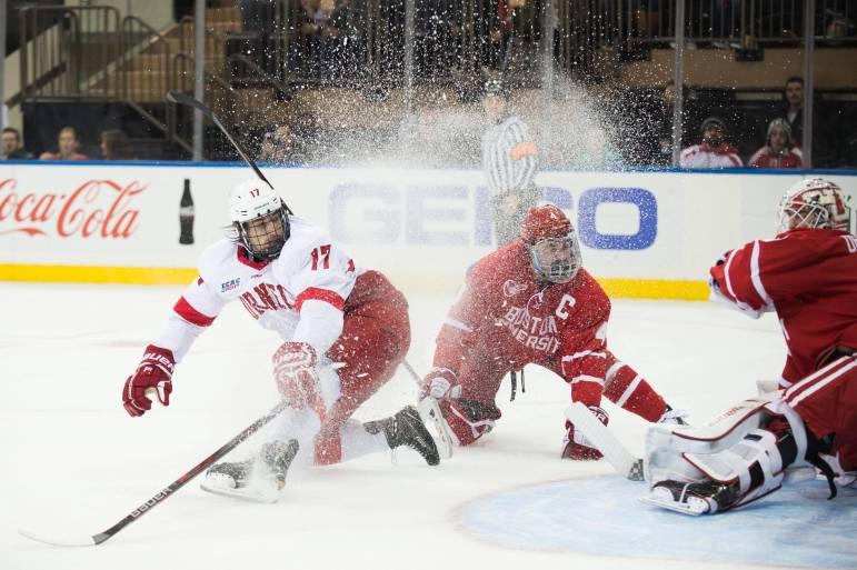 Anthony Angello sprays ice at BU goaltender Jake Oettinger. Despite not landing on the scoresheet, Angello played an integral role in his team's win.