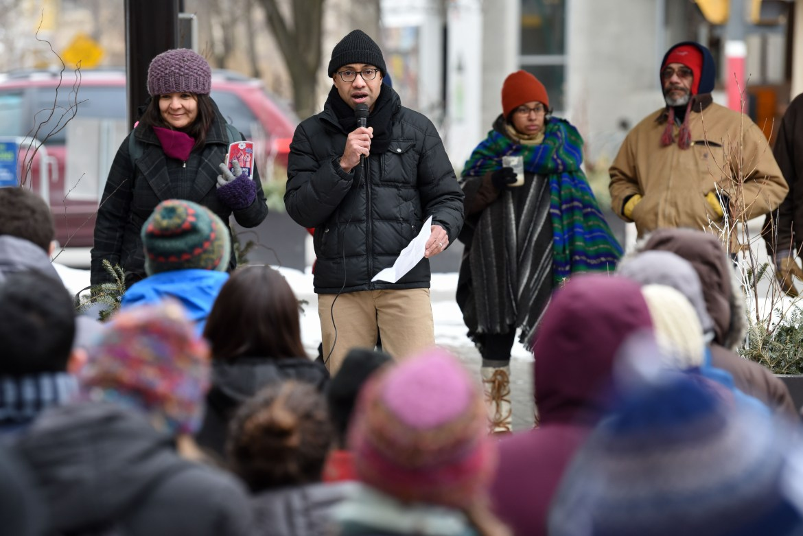 About 50 people, including Prof. Russell Rickford, center, rallied on the Ithaca Commons on Feb. 6, 2018, protesting immigration agents' arrest of three Ithaca residents in January.