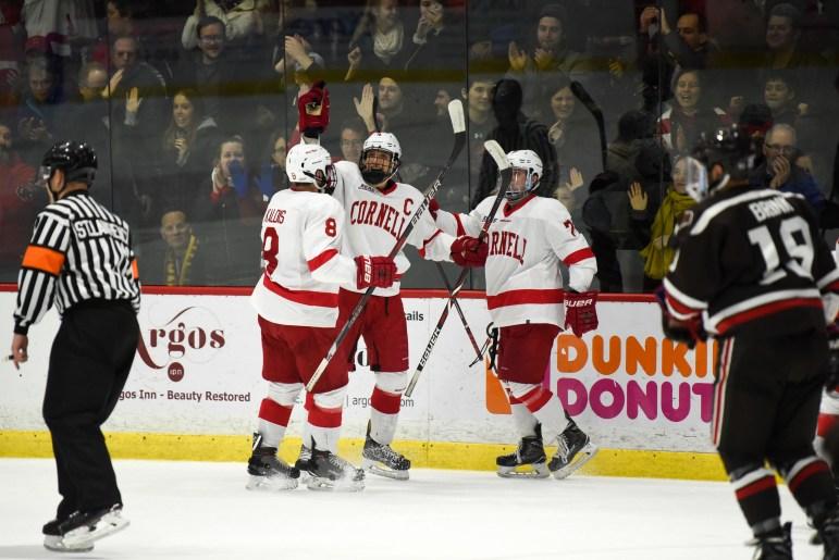 The Red skated past RPI, 4-2, winning the ECAC regular season title.