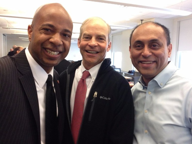Prof. Soumitra Dutta, right, the former dean of the College of Business, with H. Fisk Johnson '79, center, the CEO of SC Johnson for whom the business college is named, in April 2016.