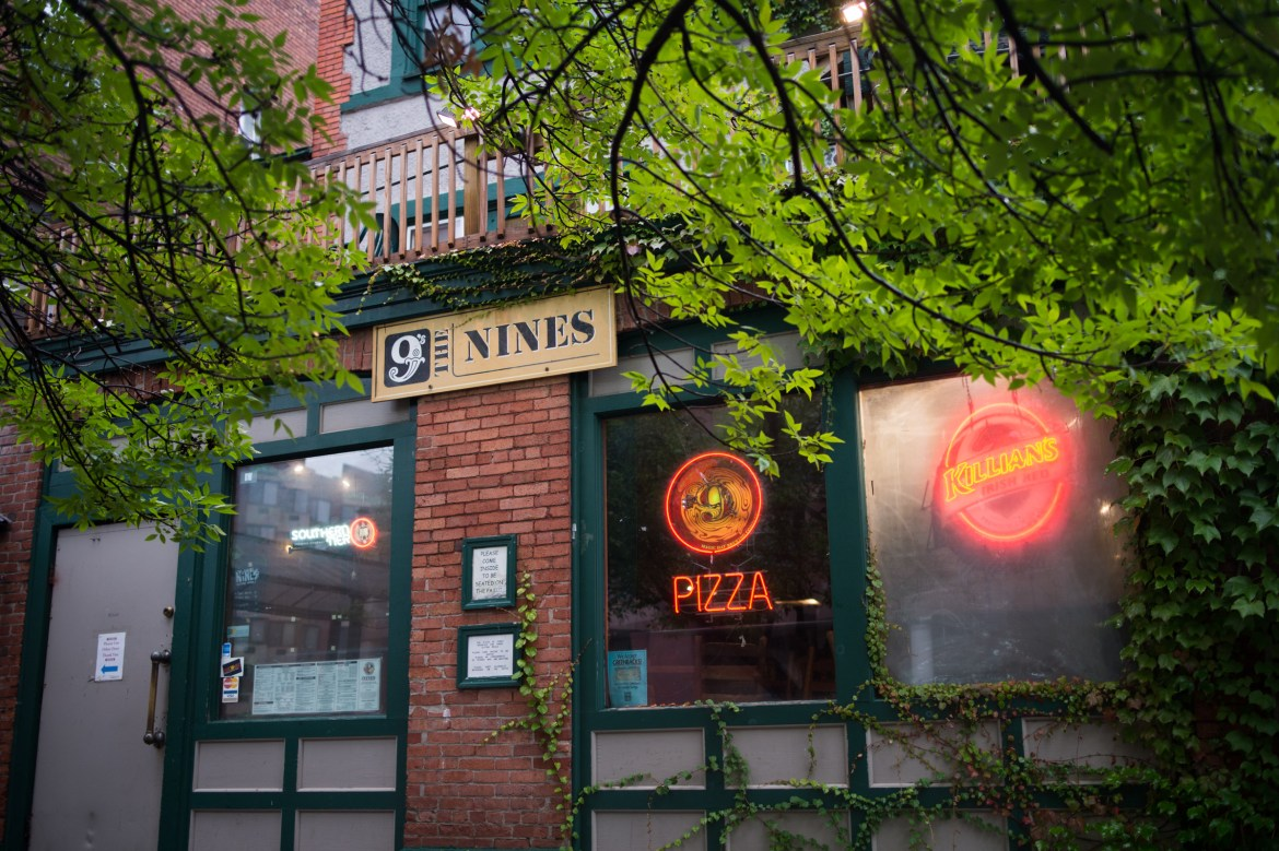Granting the popular bar and pizza joint landmark status would prevent significant exterior modifications.