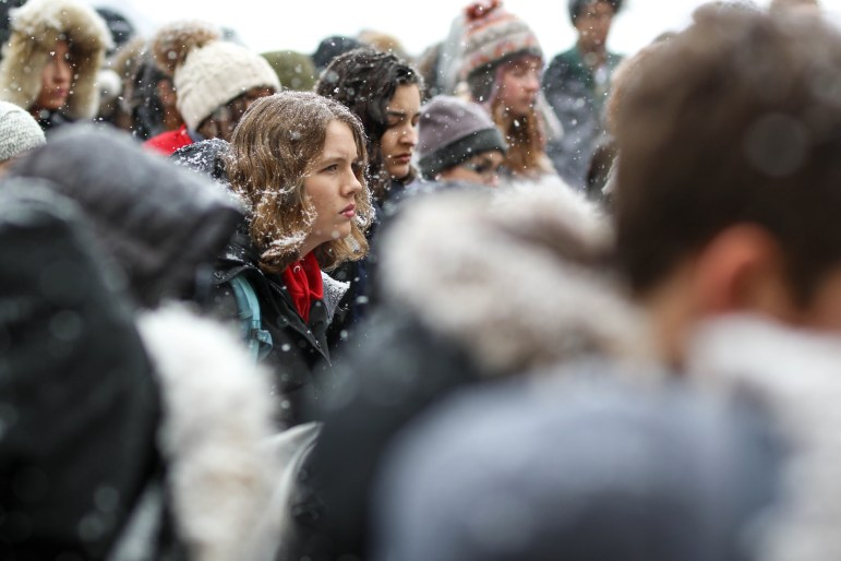 Despite the heavy snow, students gathered at the Arts Quad on Wednesday to protest against gun violence.