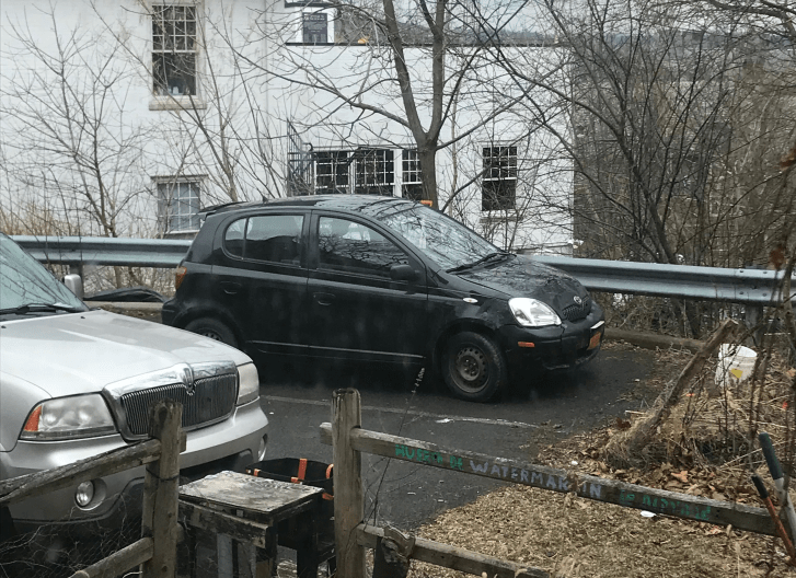 Police pulled over the two men, who were driving the Toyota Echo, and accused them of stealing the vehicle. Police later moved the car to the parking space above.