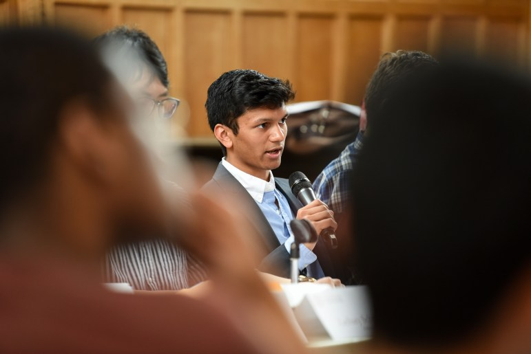 Varun Devatha '19, Student Assembly executive vice president and president-elect, speaks at the S.A. meeting on Thursday, during which the S.A. voted to dedicate a greater proportion of funding for Senior Days activities accessible to low-income background seniors.