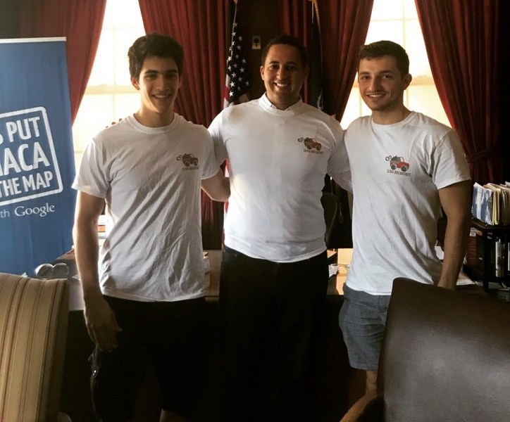 Suna Breakfast team members Pedro Bobrow '20 and Benjamin Finklestein '20 pose with Mayor Svante Myrick '09 after donating over 200 free meals to the homeless population in Ithaca.
