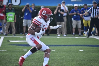 Running back Chris Walker, pictured above in the game against Delaware last season, is expected to return from injury this weekend.
