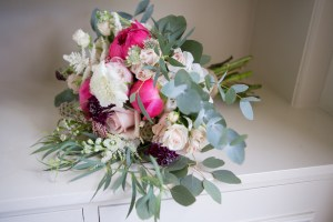 Bridal bouquet with coral charm peonies, quicksand roses, rose flower and eucalyptus