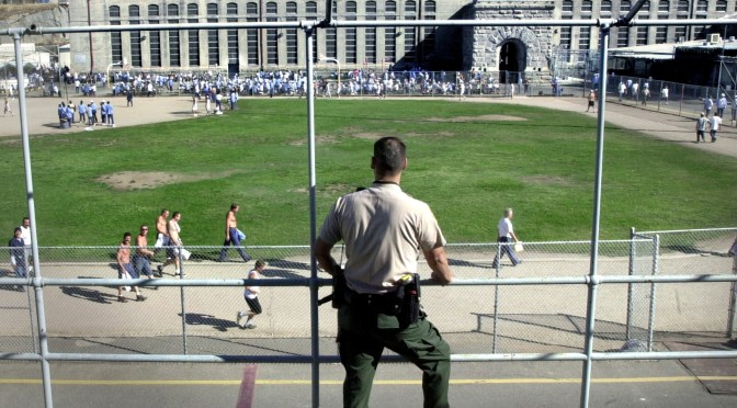 "For the first time in many years, the California Department of Corrections reports that there has been a slight decline in the state's prison population.  At Folsom State Prison (""Old Folsom"") October 4, 2001, Correctional Officer Eric Gums watches over the prison's central exercise yard.  The Sacramento Bee / Dick Schmidt (to go with story by John Hill)"