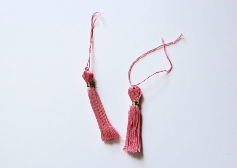 Just add tassels to a bag for instant glam! These easy DIY tassels are easy to make -- only embroidery thread needed!