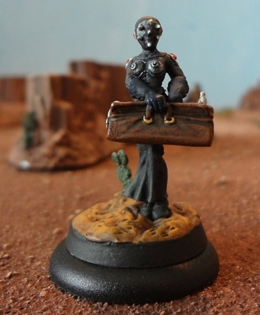 Dark Age Games Field Medic on a 25mm base successfully stacked on a 30mm base.