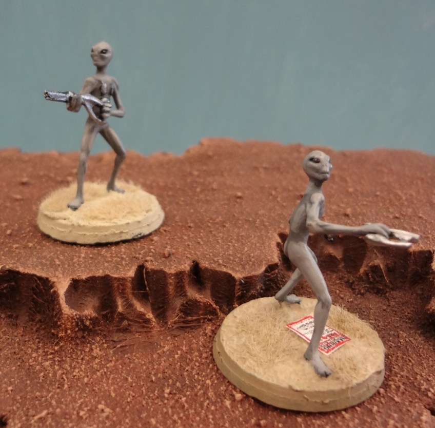 Grey Alien miniatures from Area 51 Miniatures perched atop a Martian mesa.