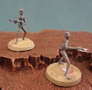 Grey Alien miniatures from Area 51 Miniatures perched atop a Martian mesa.