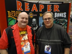 Ed Pugh and Matt Clark from Reaper Miniatures pose at the Reaper booth at the GAMA Trade Show 2012.