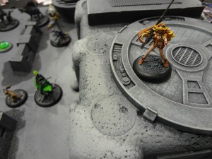 Sniper overlooks the Relic Knights demo board at the GAMA Trade Show.