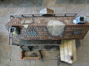 A view from above of the weathered and worn miniature fantasy inn.