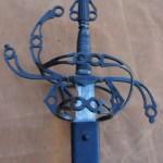 Steel sword showing pommel and intricate flowing hilt designed by David Baker